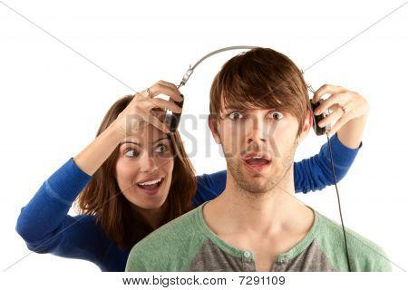 Woman Interrupts Man With Headphones