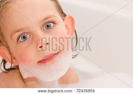 Pretty Little Girl Playing In The Bathtub