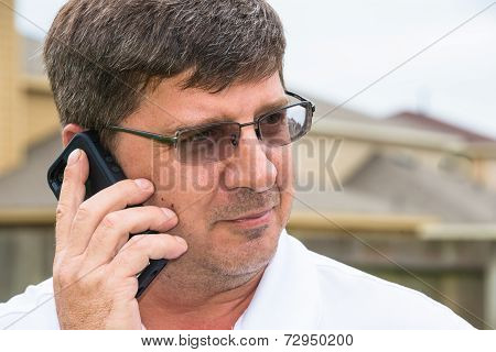 Man Listening on Smart Cell Phone