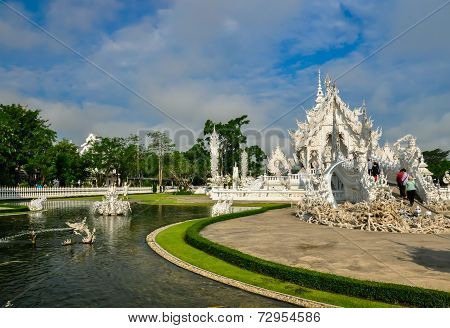 Chiang RaiThailand.- May 9 2013 : View landscape of Wat Rong Khun (White Temple) in Chiang, Thailand. poster