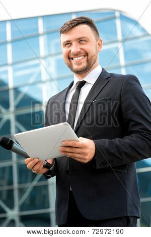 Portrait Of Well-dressed Man On Contempopary Background