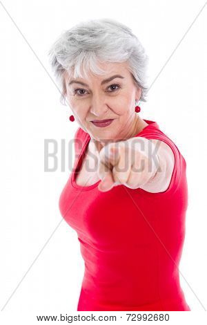 Senior woman pointing with her finger in the camera.
