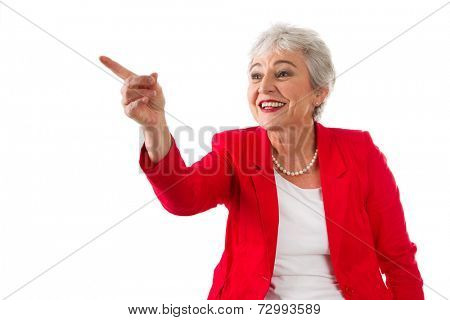 Happy senior woman pointing to the side