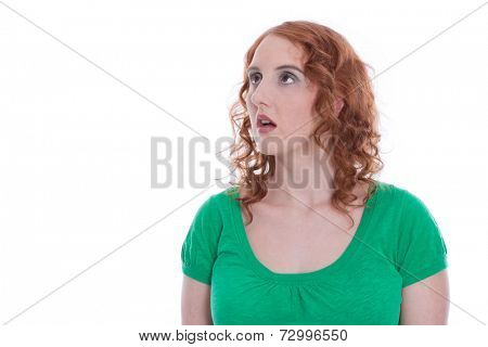 Red-haired woman amazed isolated in Green - View averted