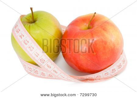 Pink Measuring Tape And Two Apples