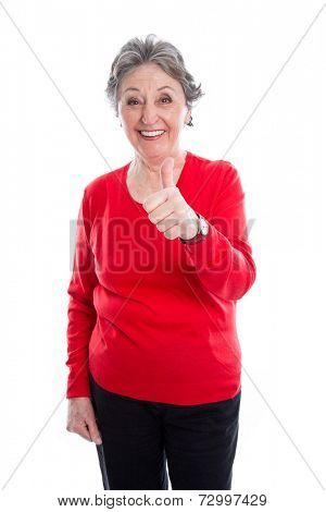 Thumb up: Portrait of an older woman in red pullover isolated