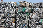 aluminum scrap awaiting recycling and helping create a cleaner environment poster