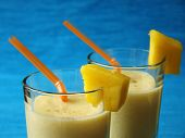 Typical Indian refreshing fruity soft drink called Mango Lassi. poster