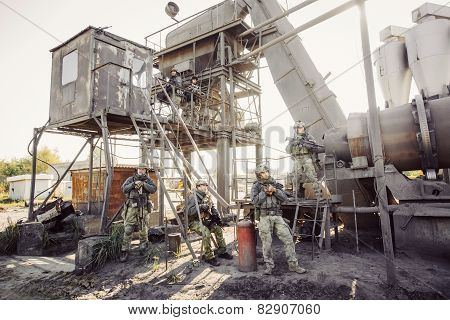 Group Of Soldiers Guarding The Plant
