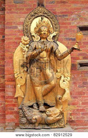 PATAN, NEPAL - APRIL 2014 : Statue of the river goddess Ganga standing on a Makara at Mul Chowk, Royal Palace in Patan, Nepal on 13 April 2014. The Ganga river is worshipped by Hindus.