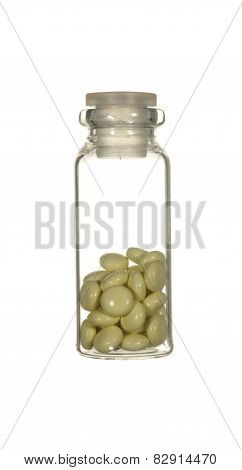 Transparent Glass Bottle Of Yellow Pills Isolated On A White Background.