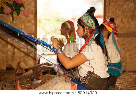 Group Of Kayan Lahwi Girl Is Weaving.