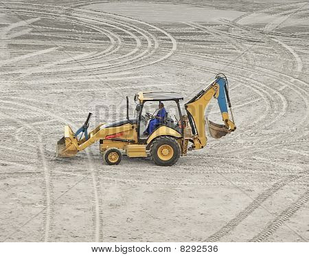 An Excavator Parked On The Sand