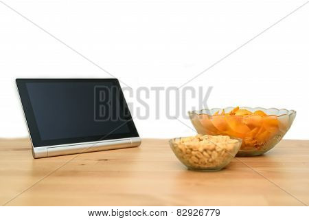 Tablet Pc With Unhealthy Snack Isolated On White Background