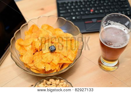 Closeup Of Unhealthy Snack And Beer With Laptop In Background