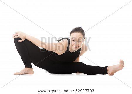 Yogi Female In Yoga Head To Knee Forward Bend Pose