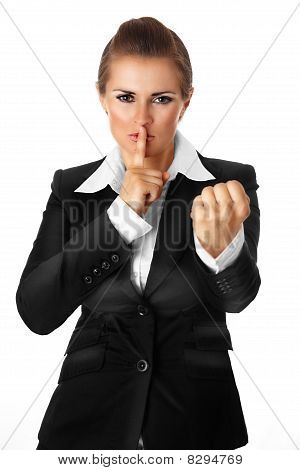 modern business woman with finger at mouth and threaten with fist