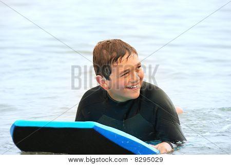 Smiling Teen Surfer