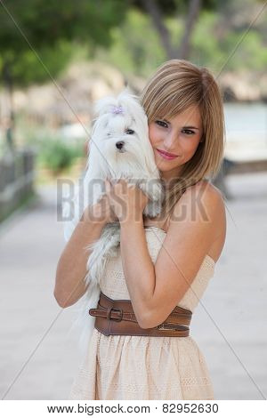 loving pet owner woman holding Maltese dog