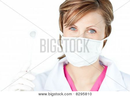Female Dental Surgeon Wearing A Mask