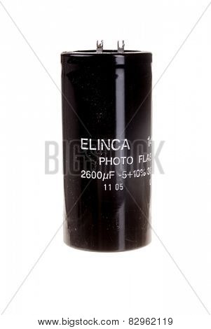 Hayward, CA - February 10, 2015: Elinca 2600 microfarad, photo Flash electrolytic capacitor, isolated on white