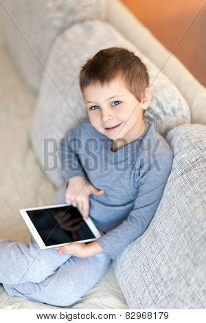 Portrait of cute boy with iPad