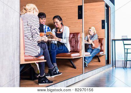 Creative business people in coworking space having meetings in cubicle offices