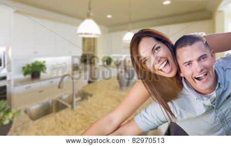 Playful Young Military Couple Inside Home with Beautiful Custom Kitchen.