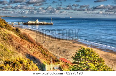 Bournemouth beach pier and coast Dorset England UK like a painting in vivid bright colour HDR