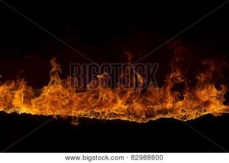 Blazing flames over black background