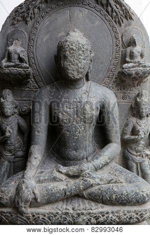 KOLKATA, INDIA - FEBRUARY 15:  Buddha seated in bhumisparsha, from 10th century found in Basalt, Bihar now exposed in the Indian Museum in Kolkata, on February 15, 2014