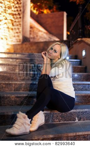 Girl That Sitting On The Stairs In Casual (night)