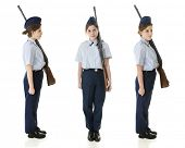 A profile, front and face right view of a Jr. ROTC teen in uniform with her rifle.  On a white background. poster