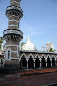 KUALA LUMPUR, MALAYSIA - DECEMBER 22, 2014: Kuala Lumpur Jamek Mosque was built in 1909, Jamek Mosque is one of the oldest mosques in Kuala Lumpur, Malaysia. It is located at the confluence of the Klang and Gombak River and was designed by Arthur Benison poster