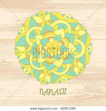 Namaste card. Cute mandala on the wood background.
