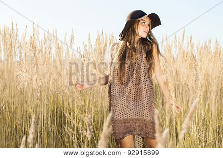 Beautiful Young Model Passing Tallgrass Meadow