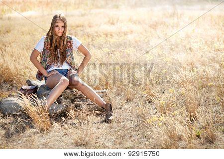 Beautiful Hippie Looking Girl Sitting On A Tree Stump