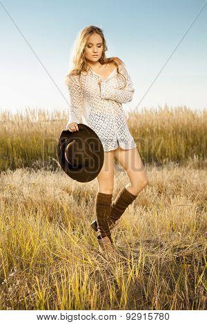 Sunrise Shot Of A Pretty Model On Meadow