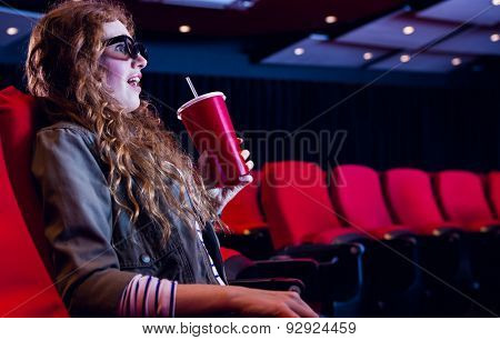 Young woman watching a 3d film at the cinema