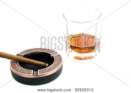 Cigarillo In Ashtray And Alcohol