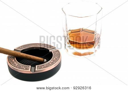 Cigarillo In Metal Ashtray And Alcohol