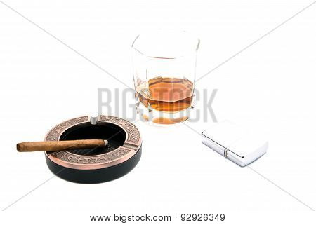 Metal Lighter, Cigarillo In Ashtray And Whiskey
