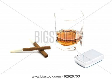Two Cigarillos, Lighter And Glass Of Cognac