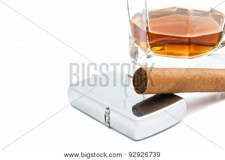 Cigar, Cognac And Lighter On White