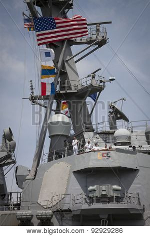 STATEN ISLAND, NY - MAY 20 2015: The conning officer, commander, and harbor master aboard the guided-missile destroyer USS Stout (DDG-55) guide the ship into port at Sullivans Pier for Fleet Week NY.