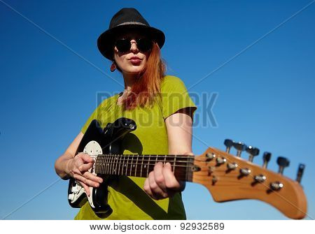 Female busker with guitar