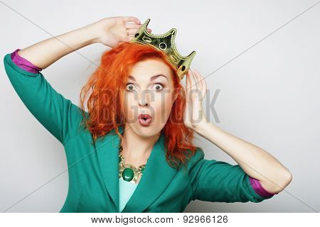 young lovely redhair woman in crown