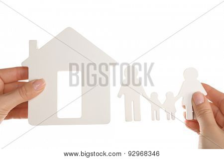 Female hands holding model of house and paper family isolated on white