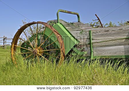 Old steel wheeled wood box manure spreader