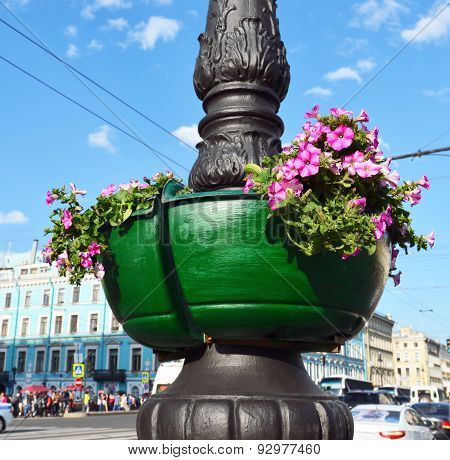 Street Vase With Red Flowers On A Column